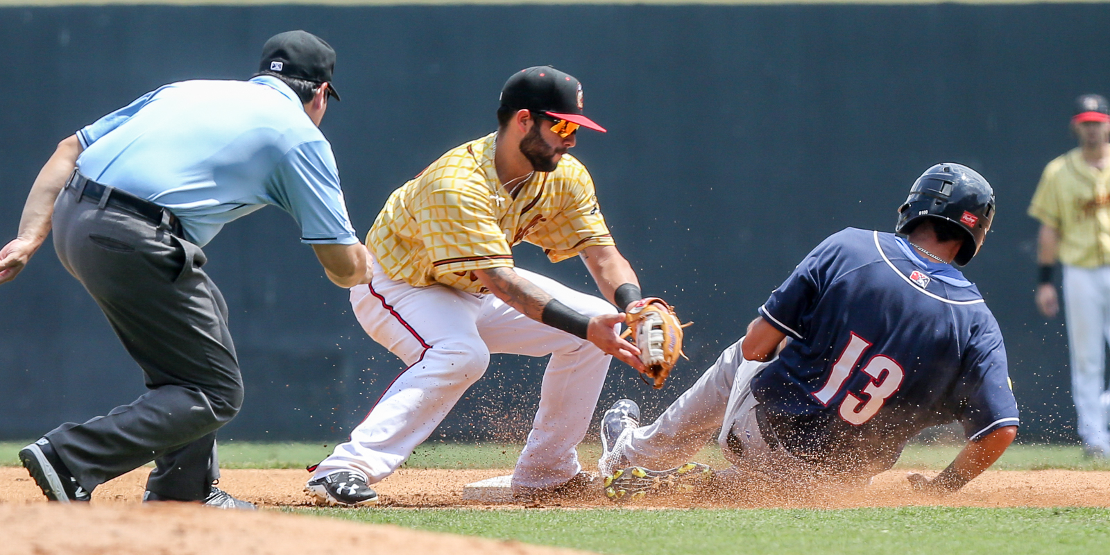 New Hampshire's Emilio Guerrero slides under C.J. Hinojusa's attempted tag at 2nd base. The 5th inning steal set up Guerrero's subsequent score to put the Fishercats up 1-0 at the Diamond Sunday afternoon, July 31, 2016. (Skip Rowland)